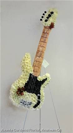 Of flowers on pinterest guitar funeral flowers and funeral tributes