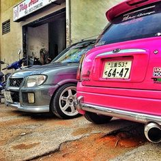 Two Daihatsu Cuore cars front and back