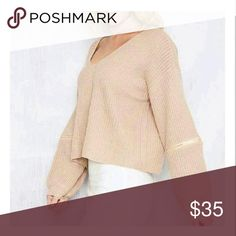 Cream V-neck autumn sweater An fashion forward sweater that comes with a choker to match. This item will definitely have all eyes on you! It can be dressed up or down. Prefect for the fall season. Sweaters V-Necks