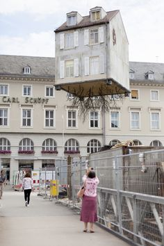 """""""Pulled by the Roots"""" (2015) by Leandro Erlich - location:  ZKM, Karlsruhe, Germany"""