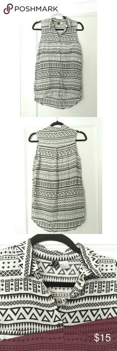H&M Tribal Boho Collared Tank Super cute black and white tank top with a collar. Wear  it under a sweater for a fun, professional pop of pattern, or on its own! It has a slightly longer back hem than the front. It is in great condition! Its marked as a size 8, but I would say it definitely runs small! H&M Tops Tank Tops