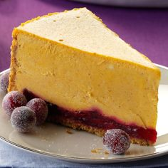 Pumpkin Cranberry Cheesecake Recipe -One Thanksgiving, I was eating pumpkin pie and decided to have some cranberry sauce with it. I loved the combination so much, I experimented and came up with a two-tone cheesecake that has a ruby-red layer at the bottom. —John Abraham, Boca Raton, Florida