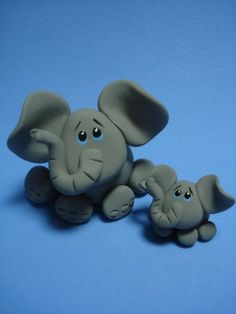 Elephant Clay Figurine - Natalie's cake topper with a pink bow, holding a yellow pinwheel, 3 inches tall.