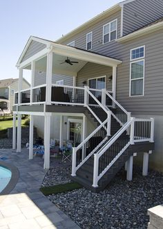 This custom TimberTech porch was constructed using Silver Maple decking and white vinyl railings. The porch is completed with recessed lights and a white bead b Screened Porch Designs, Screened In Deck, Backyard Patio Designs, Pergola Patio, Patio Ideas, Patio Awnings, Back Deck Ideas, Balcony Deck, Deck Stairs