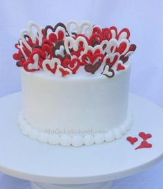 heart cake - love the candy melts on top, could adapt to anything! Valentine Desserts, Valentines Day Food, Valentine Cake, Pretty Cakes, Cute Cakes, Beautiful Cakes, Amazing Cakes, Fondant Cupcakes, Cupcake Cakes