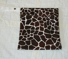 Use discount code LETITSNOW2013 at check out to receive 15% any item in our shop!    Store All Small Giraffe Print Wet Bag  Hanging by WetBagIt on Etsy, $13.99