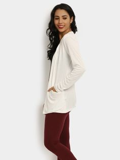Create a modish look by teaming this shrug with a black top and a pair of maroon jeggings. Complete the ensemble with a pair of black embellished sneakers.