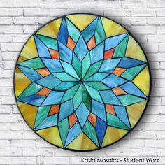 Student Work by Emily created in a Kasia Mosaics Stained Glass Mosaic Flower Mandala Workshop. Sign up for an Online Class, an All Level Studio Class or purchase project kits via www.kasiamosaics.com