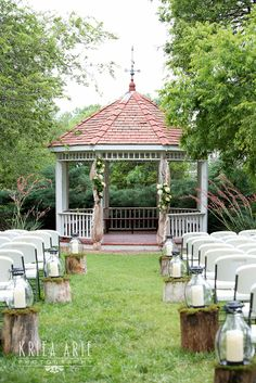 Sue & Lou Events- Sue & Lou Events- Wedding Ceremony Gazebo and aisle- stumps, lanterns, moss, burlap- awesome! - Real Oklahoma Barn Wedding at the Harn Homestead. Vintage, rustic elegance! www.sueandlou.com
