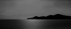 """Moody lake in B&W - This is Sevan Lake in Armenia, processed in black and white to add a sense of mood. I hope you like. You can see more  of my photos at:  <a href=""""www.photojohnwright.net"""">photojohnwright.net</a>"""