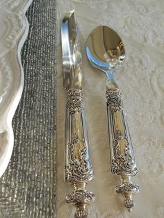 Tablescape with exquisite sterling silver flatware. Luxe.