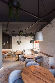 Interior photography: SNOOZZ Cafe in Oradea, Romania on Behance Interior Photography, Romania, Coffee Shop, Conference Room, Behance, Cozy, Ceiling Lights, Modern, Table