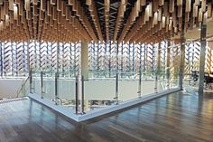 Moveable wooden screens are set into concrete facades of wood museum
