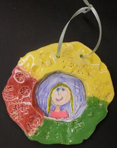 Panther's Palette. 1st grade clay picture frames with self portraits.