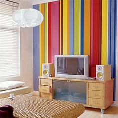 Love bright colors but can't narrow it down to one?  Try painting an accent  wall with stripes of all of your favorite hues. | Photo: Richard Powers/Arcaid/Corbis | thisoldhouse.com