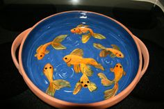 Serving Dish redecorated and recycled into birdbath. Porcelaine ceramic paints used to paint goldfish.