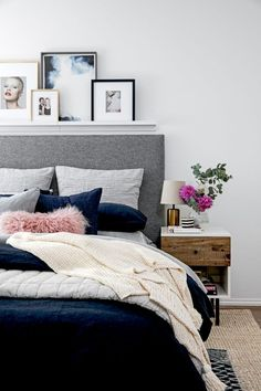 The dark navy blue makes the shades of pink in the bedroom really stand out! I wouldn't want to leave my bedroom if it looked like this.