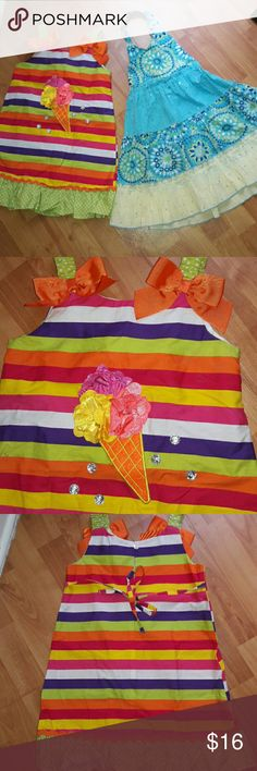 💙Lot of 2 Girls Dresses💛 Striped multi colored dress with lime green and white polka dot straps and ruffled bottom; has a 3D ice cream cone made out of pink yellow and orange satin ruffles, surrounded by large rhinestones, back tie,  brand-Youngland. Halter dress is lt. blue royal blue lt. yellow and white white little iridescent rhinestones all over. Back tie and buttons around neck, brand-Blueberi Boulevard. Both are size 5 and in excellent used condition! Dresses Casual