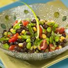 Colorful and great reviews - Corn, edamame, tomatoes, green onions, black bean salad with cilantro and lime/wine vinegar dressing.