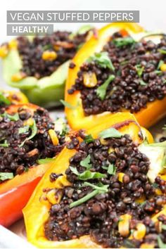 This delicious vegan recipe is perfect for lunch or dinner. Capsicum peppers stuffed with beluga lentils, red quinoa, sweetcorn and spinach cooked in a rich tomato sauce. Delicious Vegan Recipes, Whole Food Recipes, Vegetarian Recipes, Healthy Recipes, Drink Recipes, Keto Recipes, Dinner Recipes, Vegetarian Stuffed Peppers, Easy Vegan Dinner