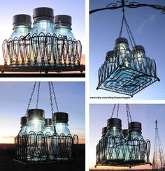 Mason Jar Chandelier with Solar Lights. I think I have plently of jars to do this with! the jar holders are on clearance at wm Ball Jar Lights, Mason Jar Solar Lights, Solar String Lights, Solar Lanterns, Mason Jar Lighting, Bottle Lights, Light String, Kitchen Lighting, Solar Chandelier