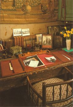 """Vita Sackville-West's desk  """"Heaven preserve me from littleness and pleasantness and smoothness. Give me great glaring vices, and great glaring virtues, but preserve me from the neat little neutral ambiguities. Be wicked, be brave, be drunk, be reckless, be dissolute, be despotic, be a suffragette, be anything you like, but for pity's sake be it to the top of your bent. Live fully, live passionately, live disastrously. Let's live, you and I, as none have ever lived before."""" — Violet Trefusis"""