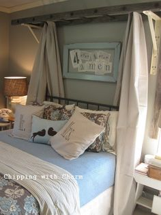 An old ladder makes a unique canopy for a bed. Unique Ways to Decorate with Vintage Ladders - Driven by Decor) Room, House, Home Goods, Driven By Decor, Interior, Home, Home Bedroom, Bedroom Diy, Diy Furniture Bedroom
