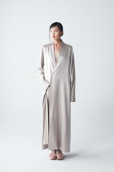 Yael Dress Coat | NEEMIC | NOT JUST A LABEL  Pale silver coloured light overcoat with a deep v-neck, a with a one button closure and slit in the back.