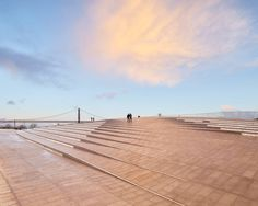 the new museum of art, architecture and technology (MAAT) by AL_A studio is located on the banks of the tagus river in lisbon.