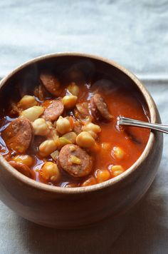 A quick spicy soup recipe with chorizo, chickpeas and tomatoes.