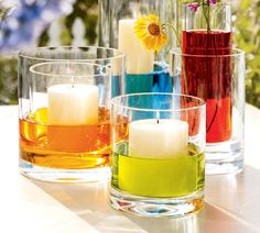 Real Simple: Ideas for Simple Glass Vases - Design Line - April 2011 just add drops of food coloring to water use white candles and . Wedding Table Centerpieces, Diy Wedding Decorations, Centerpiece Ideas, Wedding Ideas, Colorful Centerpieces, Table Decorations, Candle Centerpieces, No Flower Centerpieces, Diy Centerpieces Cheap
