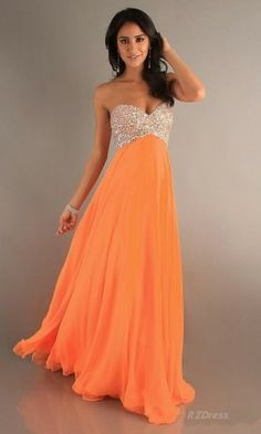 """Orange Prom Dress!  """"Trendy, Unique and Affordable"""" - That is the main philosophy at Bling Boutique in Milford, MI!  Stop by our store to find some fashionable items that will spice up your wardrobe!  Visit www.downtownbling.com or call (248)  685-8449 for more information!"""