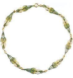 Lalique (early 20th c.) Chain: gold/ plique-à-jour enamel. The plaques are designed w/floral motifs, signed Lalique, length about 420mm
