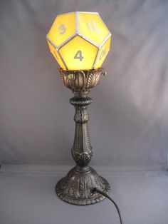d12 torch lamp in stained glass. $300.00, via Etsy. Yes, you heard that right. a 12-sided die, now as living room furniture. Geek on!