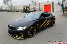 BMW M4 in Satin Black and Gold Chrome   automotive99.com