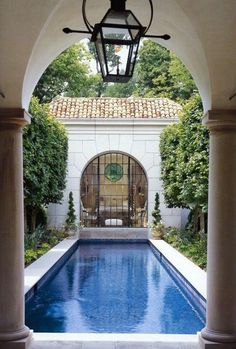 """""""Make a lap pool luxurious by anchoring the pool house and the main house with a shallow garden."""""""