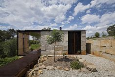 Sawmill House, Sawmill House by Archier, Archier, open plan, operable doors, operable roof, victoria, passive cooling, passive heating, patina, recycled concrete, recycled concrete blocks, industrial chic, locally sourced materials, minimalist,