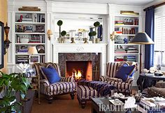 Arm chairs with faux fur throws sit in front of the library fireplace inviting a sit with a good book, or maybe even a nap.  - Photo: Tria Giovan / Design: Kenneth Alpert