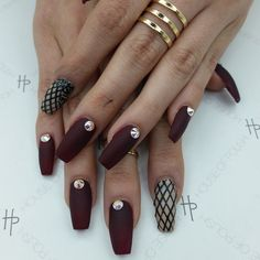 Matte black coffin nails with fishnet accent