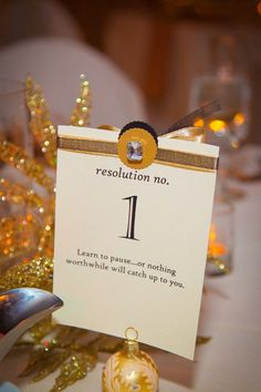 Awesome NYE wedding idea! Instead of just table number, add a clever resolution to them!