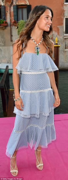 Beautiful in blue! Vikander looked relaxed and carefree in her playful frock