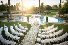 Poolside Ceremony at Sunset    Photography: Michael Segal Photography   Cody Floral Design More:http://www.insideweddings.com/weddings/poolside-ceremony-amazing-open-air-tented-reception-in-california/641/