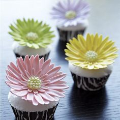 Gerbera Garden Cupcakes - Your cupcakes will blossom with beauty when you top them with a sunny gum paste Gerbera daisy! These flowers are easy to make with the cutters and instructions in our gum paste cutter set. They are a variation of the classic gum paste daisy you will learn in The Wilton Method of Cake Decorating Course 3.