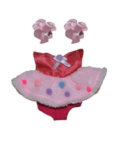 Vestido ksimerito rosa caramelo pompon para el pimpollo mas peke Medidas: Alto 17 cm Ancho 2.5 cm Largo 13 cm Peso 30 gr Material: 100% Poliñester Accesorio...