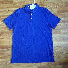 This is a purple H&M shirt. It is a basic fine cotton stretch NWT. It is a very soft shirt. One very small dis colored spot near collar.  Picture 2 represents the color f the shirt the best. If any questions feel free to ask!