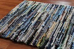 All your favorite outdoor shades - blue, cream, brown, yellow, green, and black - rolled into one thickly knitted rag rug. Made entirely by hand using upcycled t-shirts, this is one rug you can feel good about having underfoot.   T Shirt Rag Rug Utility Navy Blue Cream Gray by HandiworkinGirls, $79.95  http://www.etsy.com/listing/74513674/t-shirt-rag-rug-utility-navy-blue-cream?ref=shop_home_active
