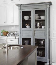 I love how a pretty cabinet can make even plain old stainless pots and pans seem pretty!