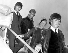 May 1964, Two of The Beatles arrive back at London Airport, from their holidays George Harrison and girlfriend Patti Boyd, John Lennon with wife Cynthia Lennon leaving the plane