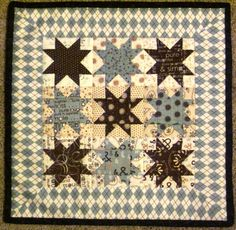 I want to make this mini quilt with little 4 inch stars. I really like this pattern.