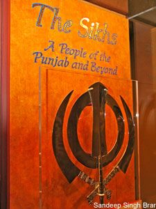 """This symbol is the Khanda and it is described as """"one of the emblems of the Sikh religion and introductory information on Sikhs and Punjab."""""""